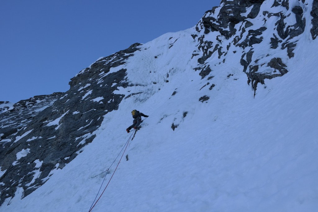 Juha starting the steep ice crux (WI5).