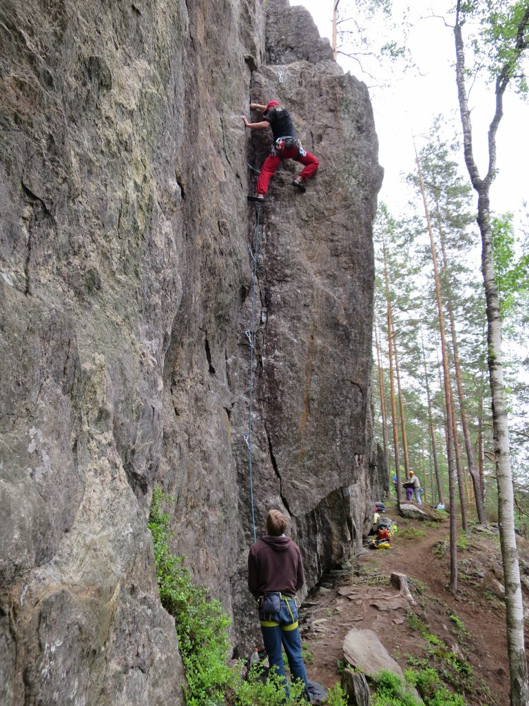 "Juho making a 2nd ascent to ""For those about to rock climb"". Lower crack was soaking wet!"