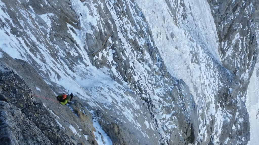 An excellent 5c pitch to reach the arete. Tim follows.